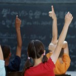 kids-raising-their-hands-in-class