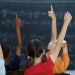 kids-raising-their-hands-in-class